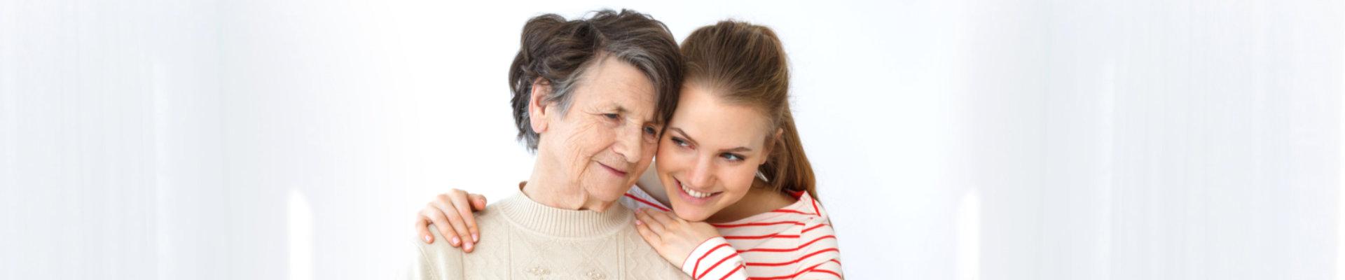 nurse hugging a senior woman