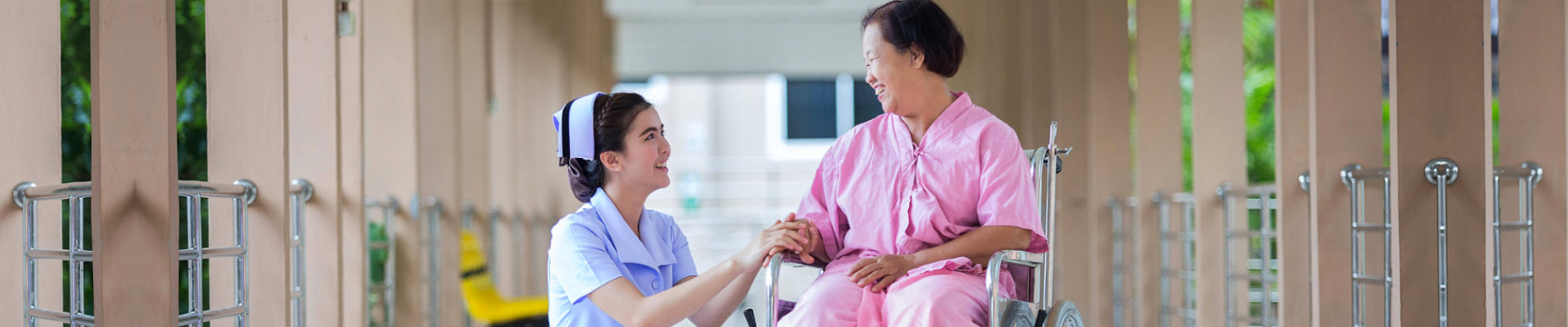 nurse talking care of her sick patient